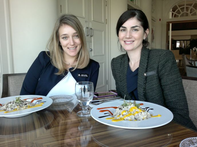 David InterContinental Hotel PR Manager Naama Ben-Dror, right, and assistant Limor Alster dining on wild mushroom risotto in the Aubergine restaurant. (Photo: Abigail Klein Leichman)