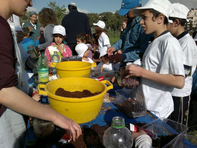 Kids had hands-on activities such as planting in old soda bottles. (Photo: Abigail Klein Leichman)