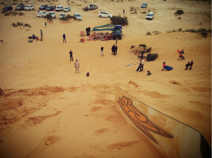 Families enjoy sandboarding near Shivta. Photo by Viva Sarah Press
