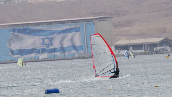 Wind surfers in Eilat enjoy a thrilling ride on the Red Sea.