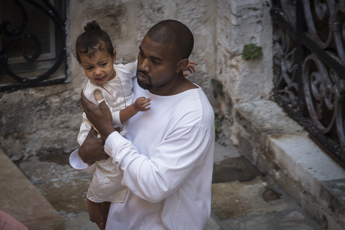Singer Kanye West, seen with his daughter, North, as they leave the Saint James Armenian Church in the Armenian Quarter in Jerusalem's Old City. (Photo by Hadas Parush/Flash90)