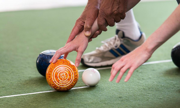 Blind lawn bowlers in Israel work with sighted coaches. (Photo: Erik Sahlin)