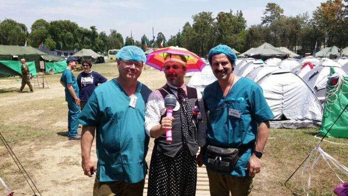 "Emek Medical Center's chief of pediatric surgery Dr. Asher Pressman and senior surgeon Dr. Yuri Berlin flanking Yaron ""Prof. Sancho"" Goshen at the IDF field hospital in Nepal. Photo courtesy of Emek Medical Center"