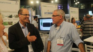 Avi Hasson, chief scientist in the Ministry of Economy, speaking with Quiet Therapeutics' Ron Lahav at IATI Biomed 2015.
