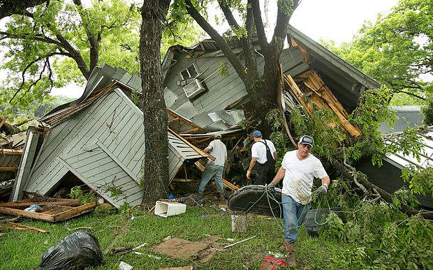 IsraAID volunteers help with removing debris from damaged houses in the Wimberley, Texas area. (photo: IsraAID)