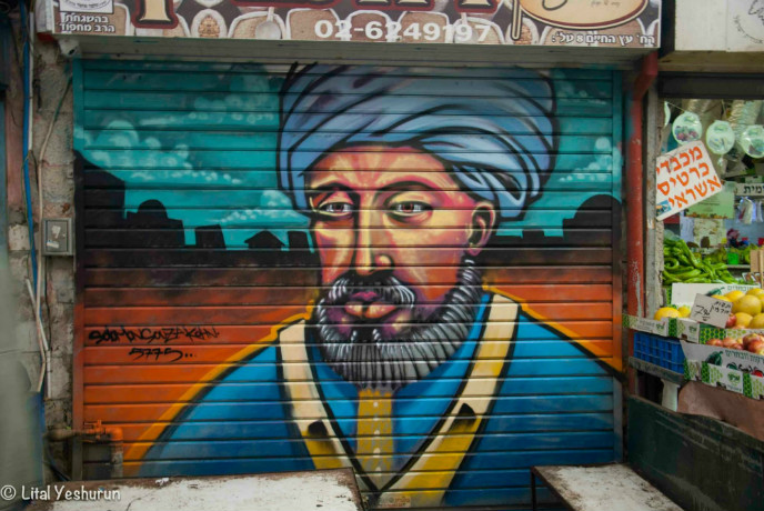 Medieval sage and physician Maimonides takes his place in the market. Photo by Lital Yeshurun