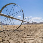 Water irrigation pipes on parched southern Californian farmland. Photo by Eddie J. Rodriguez, www.shutterstock.com
