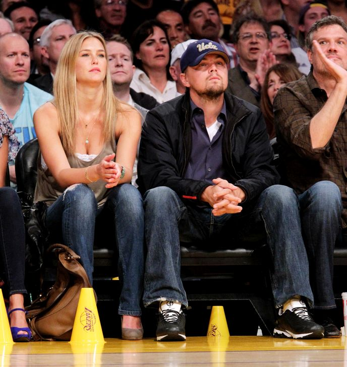 Refaeli at a 2010 basketball game with former BF Leonardo DiCaprio. Photo via PopSugar.com
