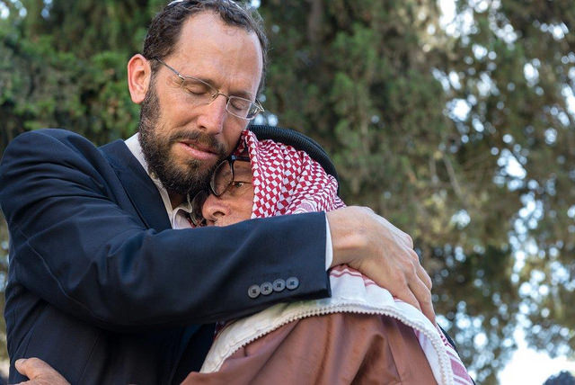 IEA participants Rabbi Yakov Nagen and Sheikh Sufi, embracing at the eighth annual Jerusalem Hug Day in June 2014. Photo by Dida Mulder