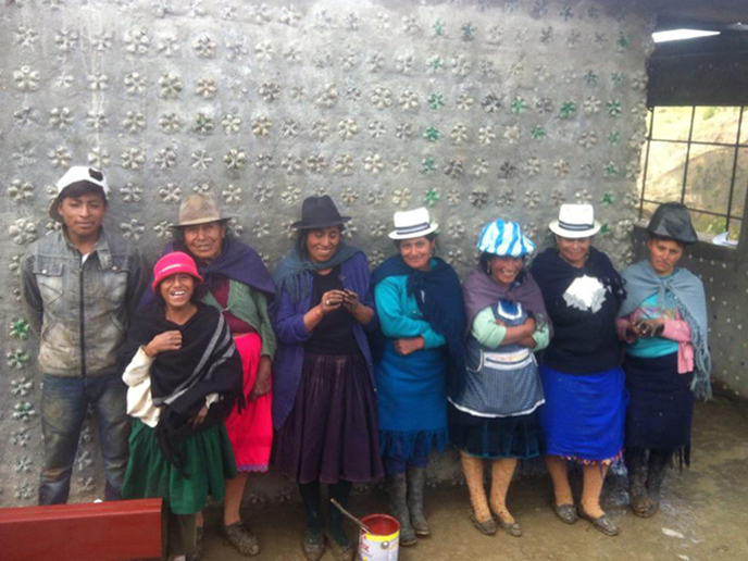 Members of the Punta Hacienda community next to the new medical clinic they built out of recycled bottles. (photo: MASHAV)