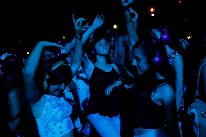 A headphone party on White Night in Tel Aviv. Photo by Flash90.