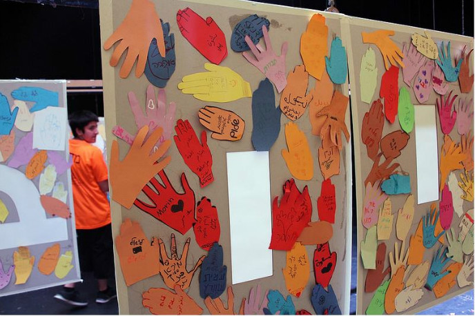 Haifa fifth- and sixth-graders created this multilingual mural of hands.