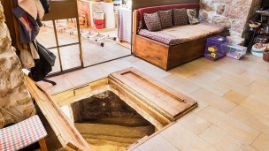 The owners installed trap doors over the mikvah opening. Photo by Assaf Peretz/Israel Antiquities Authority
