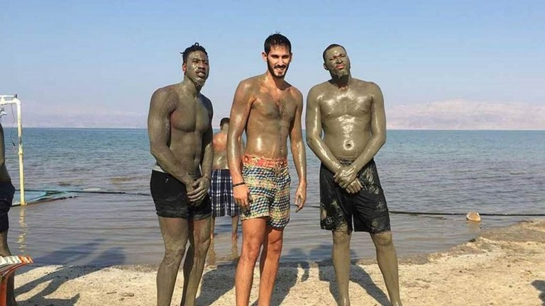Kings forward Omri Casspi, center, at the Dead Sea with teammate DeMarcus Cousins, right, and Iman Shumpert of the Cavaliers. Photo courtesy of Kings.com