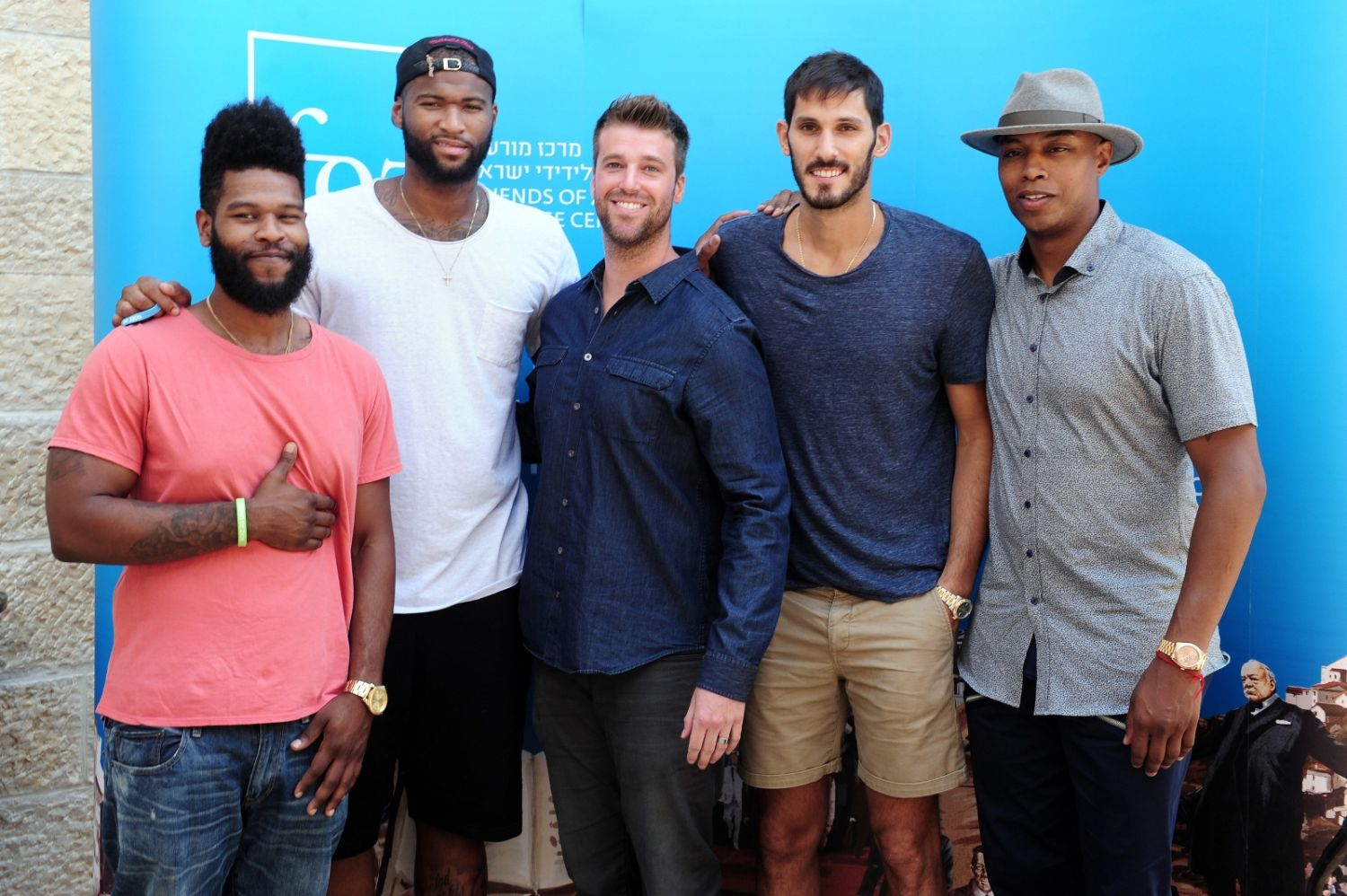 Omri Casspi, second from right, and other NBA players visiting Jerusalem's Friends of Zion museum. Photo by Kfir Sivan