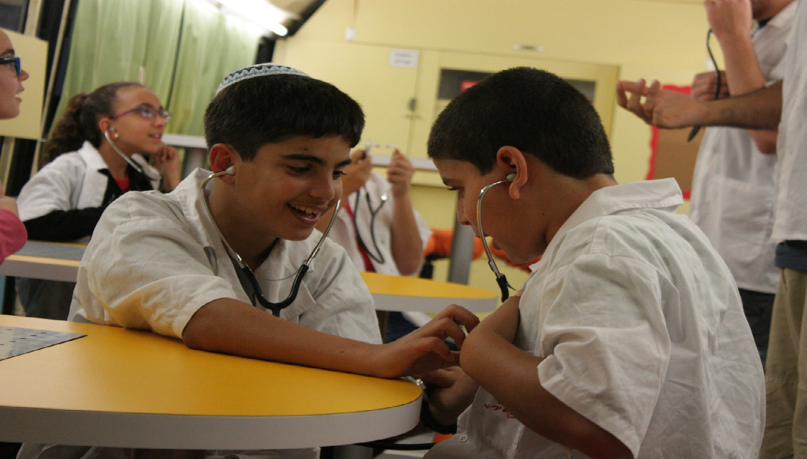 Participants in Ofanim's Young Doctors program learn about careers in healthcare. Photo courtesy of Ofanim