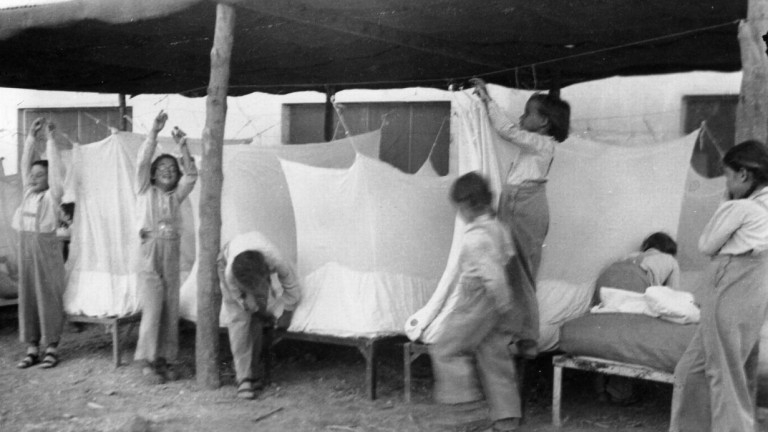 Kibbutz children preparing their summer beds, 1949. Photo courtesy of the Tirat Zvi Archive