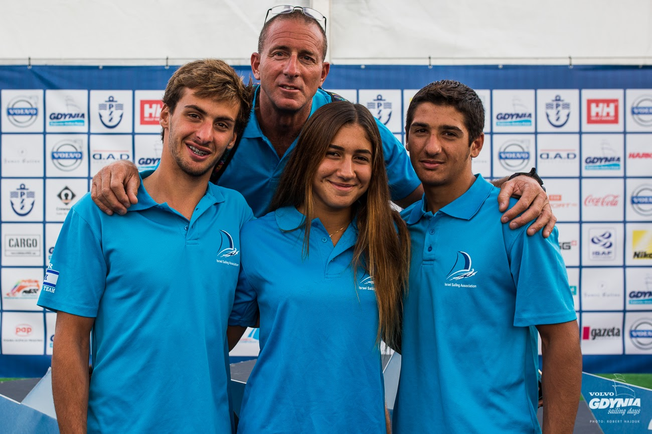 Yoav Omer, Noy Drihan and Kfir Azulay, with coach Ronnie Meir, at the closing ceremonies for RS:X Youth World Windsurfing Championships in Poland. (Photo: Robert Hajduk/ShutterSail.com)