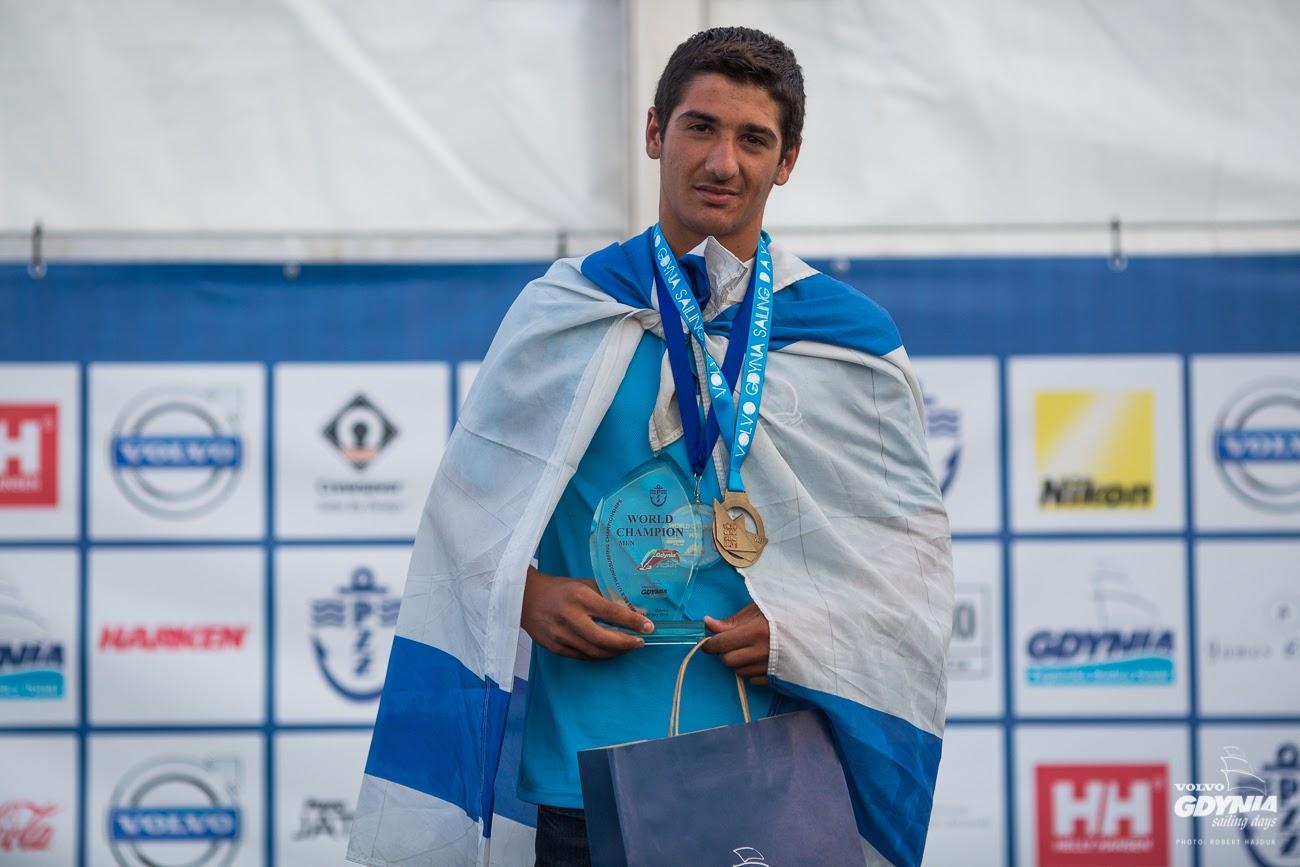Kfir Azulay celebrates gold in the RS:X U17 Youth Men category.  (Photo: Robert Hajduk/ShutterSail.com)