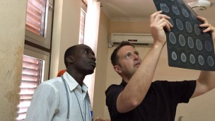 Pediatric cardiologist Dr. Sagi Assa, from the Wolfson Medical Center, working with local doctors. (Photo: SACH)