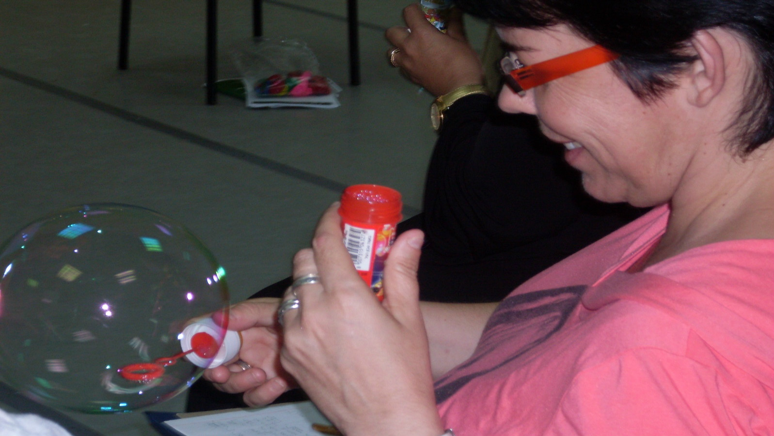A training participant practices the breathing technique by blowing bubbles. Photo courtesy of ACR