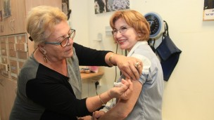 Former Israeli Minister of Health Yael German getting a flu shot last year. Photo by Isaac Harari/FLASH90