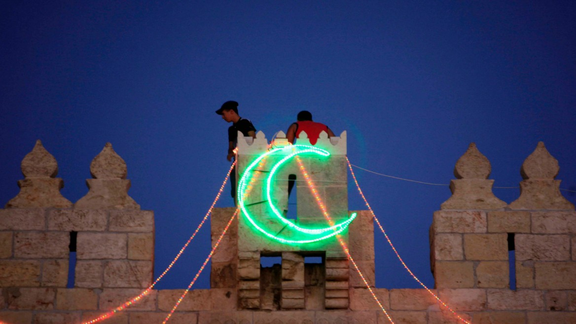 Hanging lights for Ramadan in Jerusalem. Photo by Sliman Khader/FLASH90