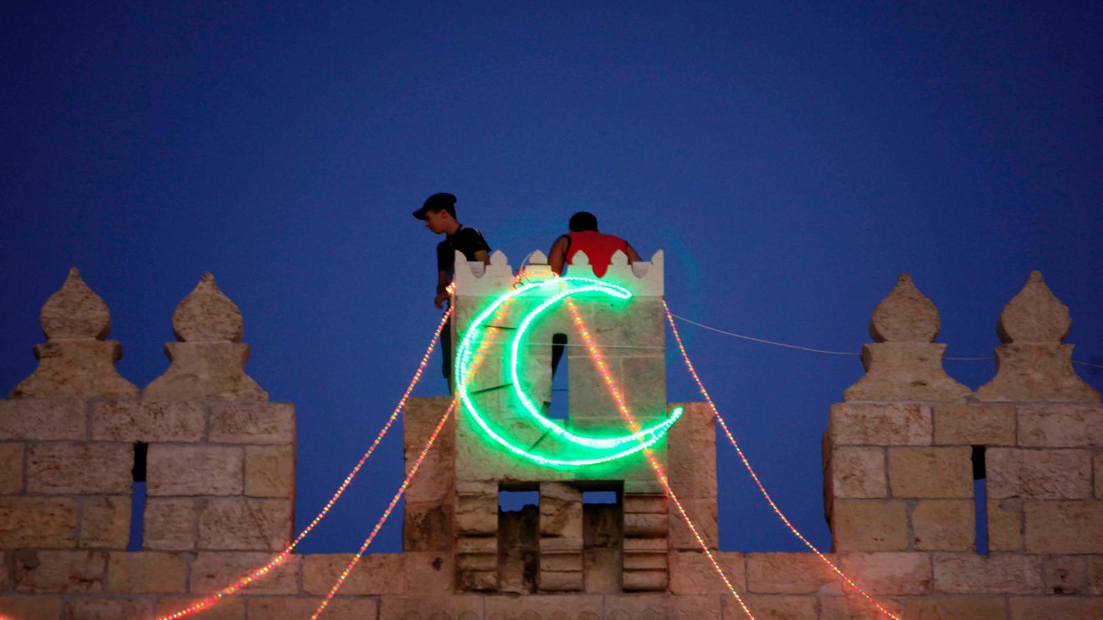 Hanging lights for Ramadan in Jerusalem. Photo by Sliman Khader/FLASH90