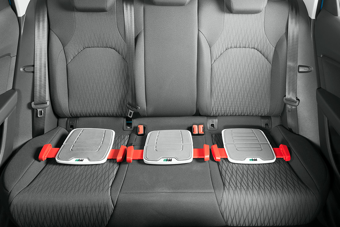 Three of the booster seats can fit comfortably in the backseat of the car. Photo: courtesy