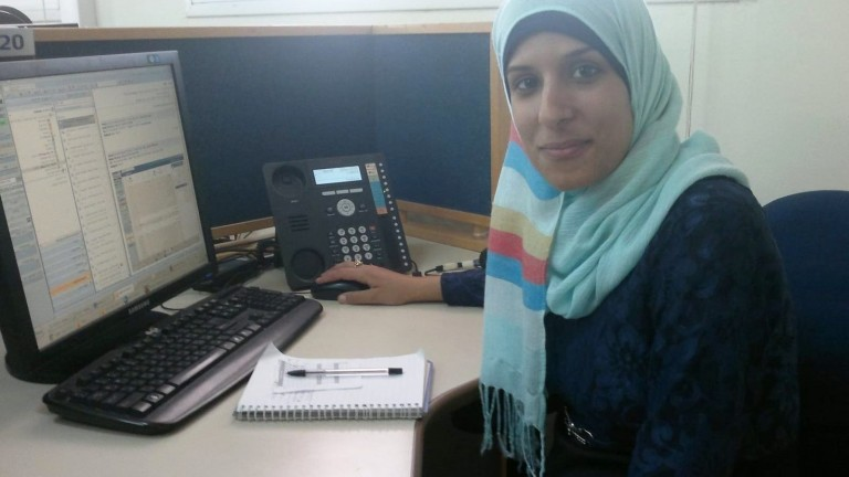 Zainab at her desk in the Bezeq call center in Hura. Photo by Abigail Klein Leichman