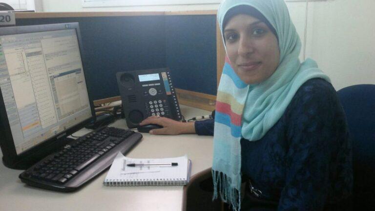 Zainab at her desk in the Bezeq call center in Hura. Photo by Abigail Klein Leichman