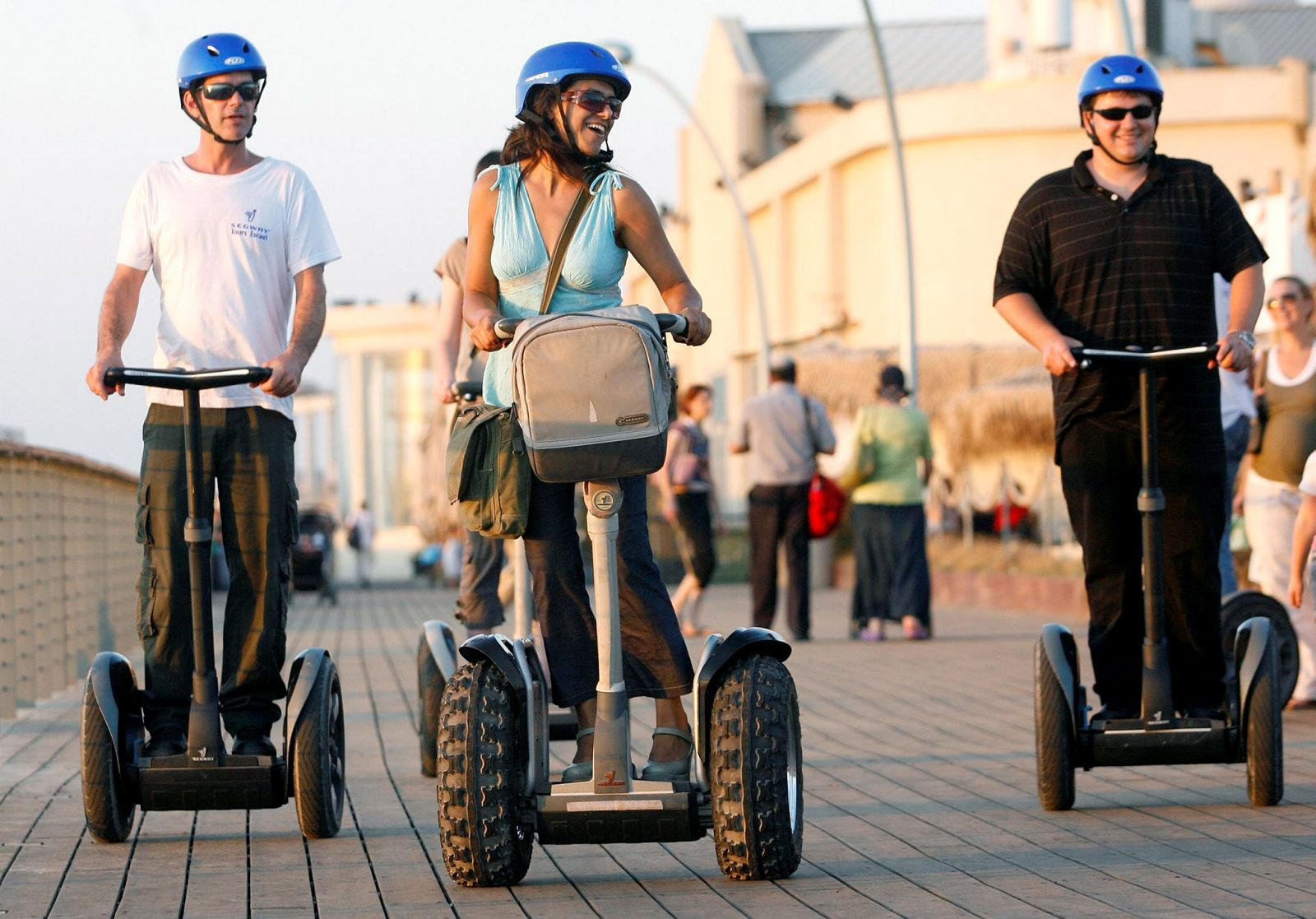 Tourists take a Segway ride along the boardwalk in Tel Aviv. Photo by Moshe Shai/FLASH90