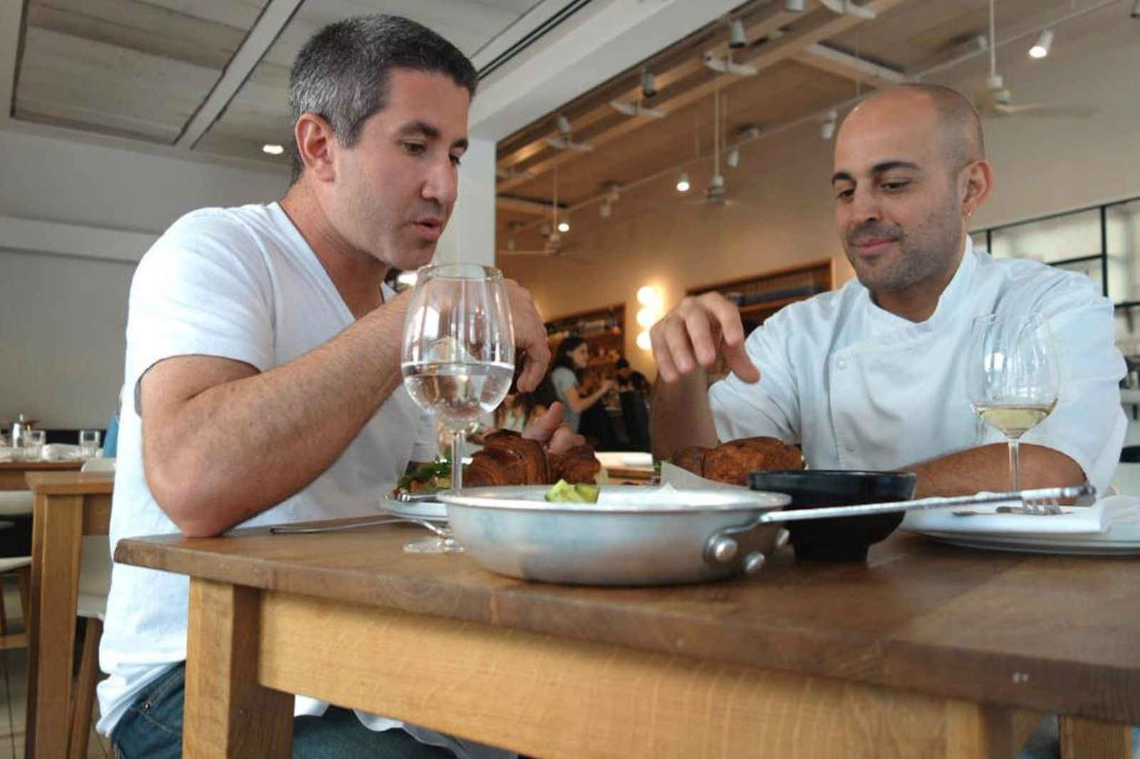Solomonov dining with Israeli celebrity chef Meir Adoni in Tel Aviv. Photo courtesy of Florentine Films