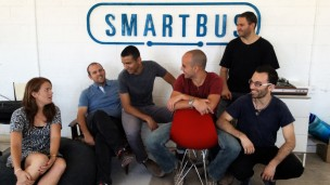 Yishai Cohen (middle, in gray shirt) with the SmartBus crew in Jerusalem. Photo courtesy of SmartBus