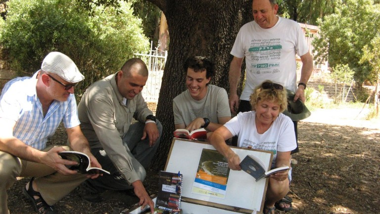 At the Tel Dan Trail Library, from left: Shalem College Prof. Ido Hevroni; Ravi Davos from INPA; hiker Royi Sokolovsky, who advocated for the Trail Libraries; and Raya and Yossi Epner of Nifgashim Beshvil Israel. Photo courtesy of Shalem College
