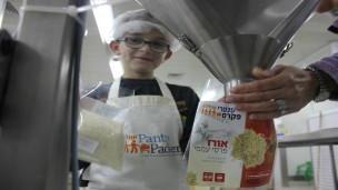 A young Pantry Packer on the job. Photo courtesy of Colel Chabad
