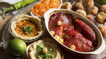 Hummus and salads are a popular Israeli staple. Photo via www.shutterstock.com