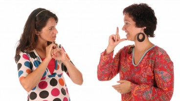 Sign language. Photo via www.shutterstock.com