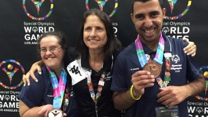 Israeli Special Olympics medalists rejoicing with their coach. Photo via Facebook