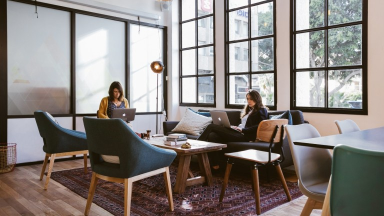Lamps and chairs are similar throughout the WeWork network but local designers add their own touches. Photo by Shiran Carmel