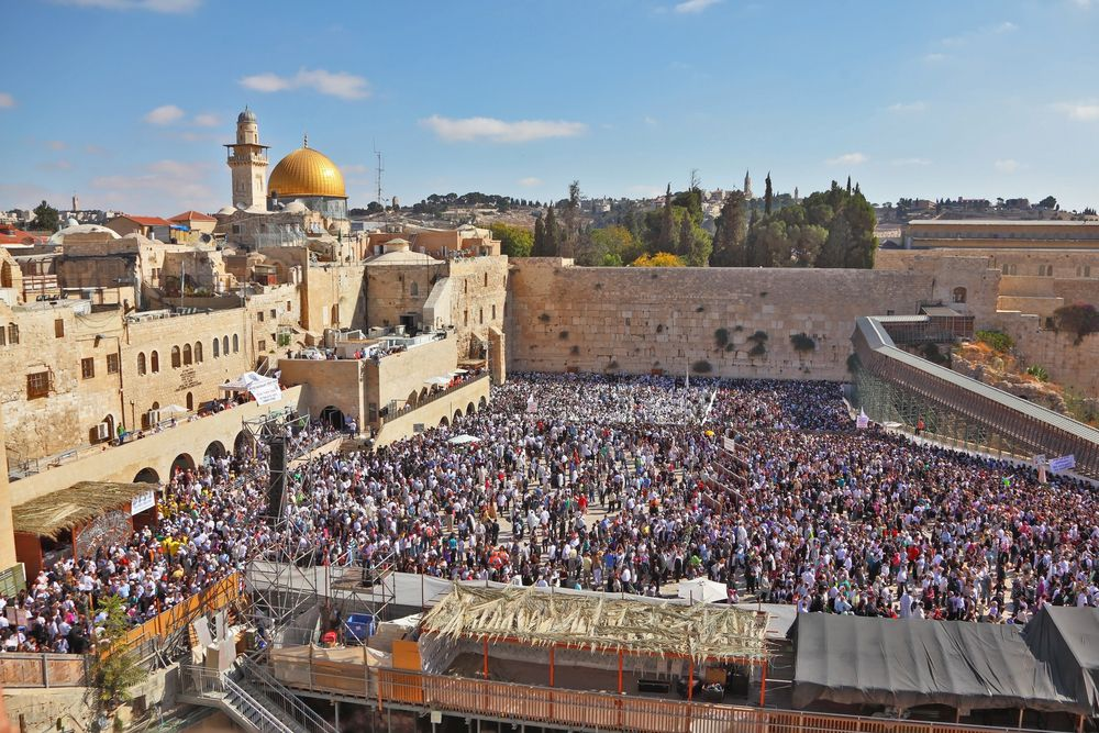 Tens of thousands of Jews gather for a pre-Yom Kippur mass prayer for forgiveness (slichot) at the Western Wall in Jerusalem's Old City. Photo via Kavram/Shutterstock.com