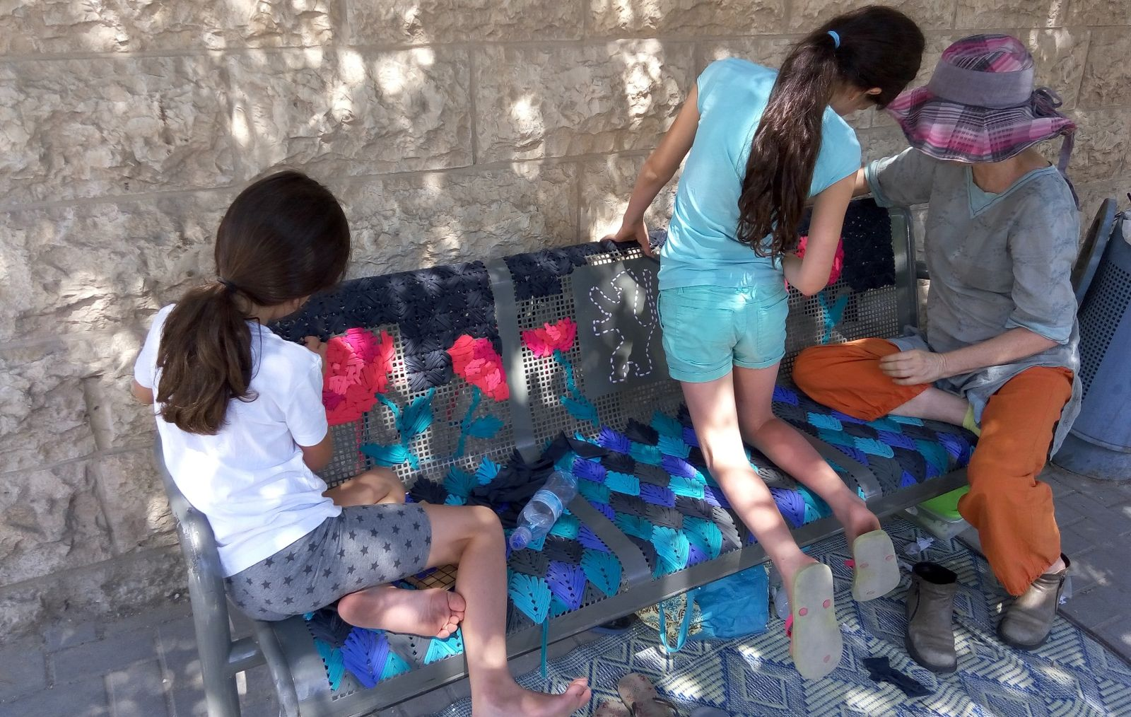 Volunteers helping Adi with the bench project. Photo: courtesy