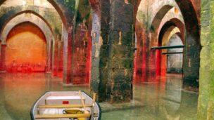 Boating through the underground reservoir in Ramle. Photo via BibleWalks.com