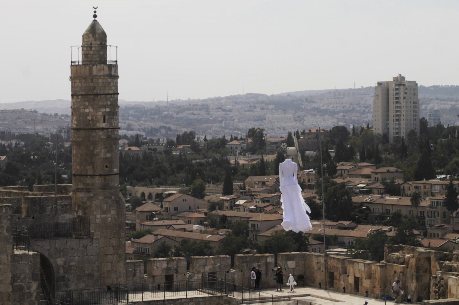 Motti Mizrahi's suspended dress installation at the Tower of David Museum for Biennale 2015.  Photo by Ricky Rachman