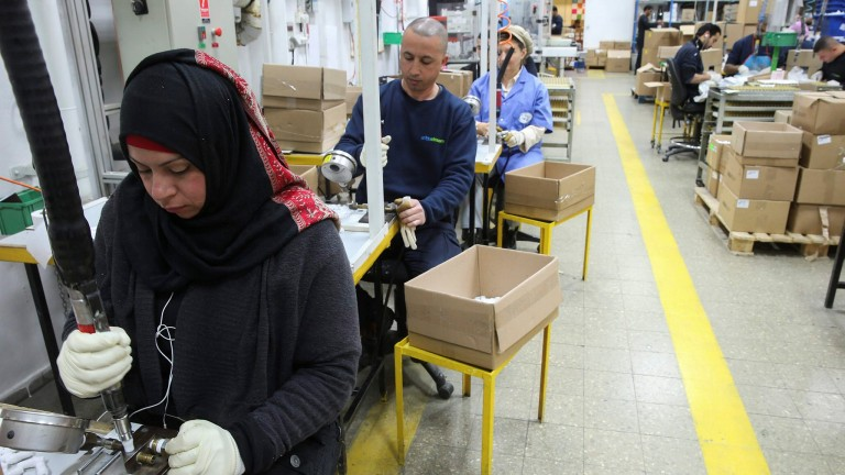Palestinians and Jews  working together at the former SodaStream factory in Maale Adumim. Photo by Nati Shohat/Flash90