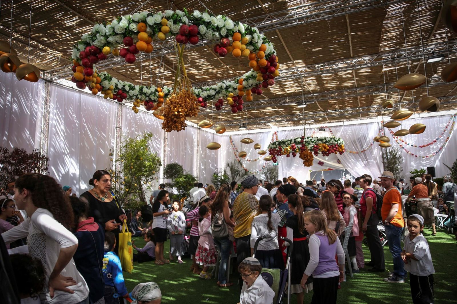 Visitors pack Jerusalem's Safra Square sukkah every year. Photo by Flash90