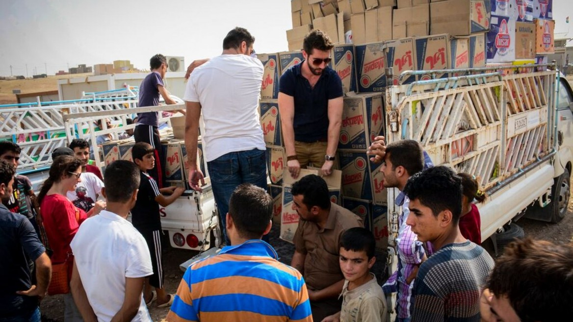 IsraAID relief volunteers distributing supplies in Iraq last month. Photo: courtesy