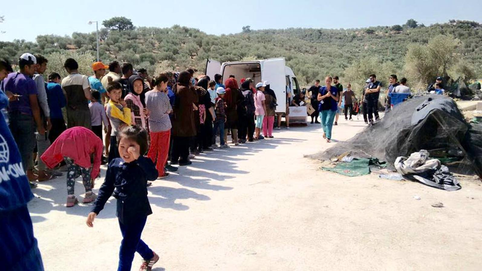 IsraAID distributing aid to refugees arriving in Lesbos. Photo via Facebook
