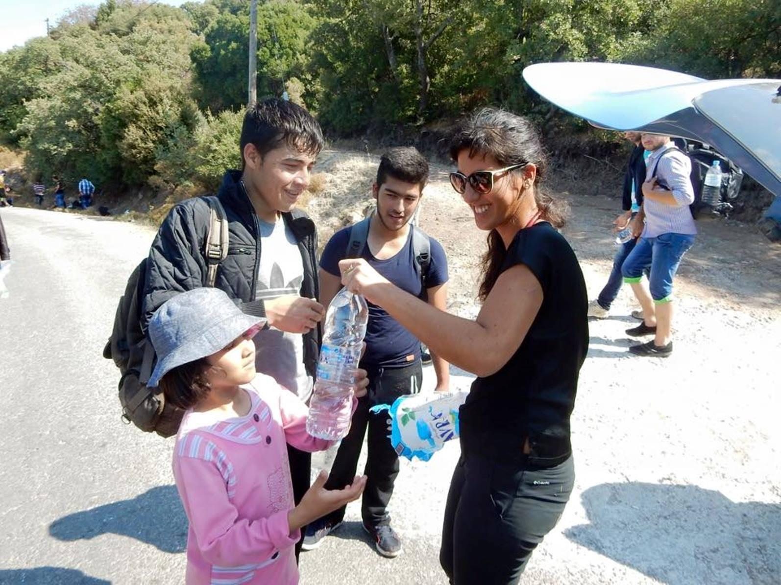 IsraAID volunteers distributed water and fruit in a refugee camp. Photo via Facebook