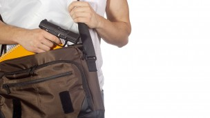What kind of person brings a gun to school? Image via Shutterstock.com